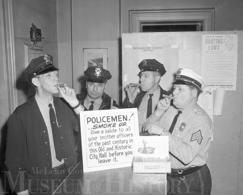 Bloomington policemen enjoying cigars, 1963.