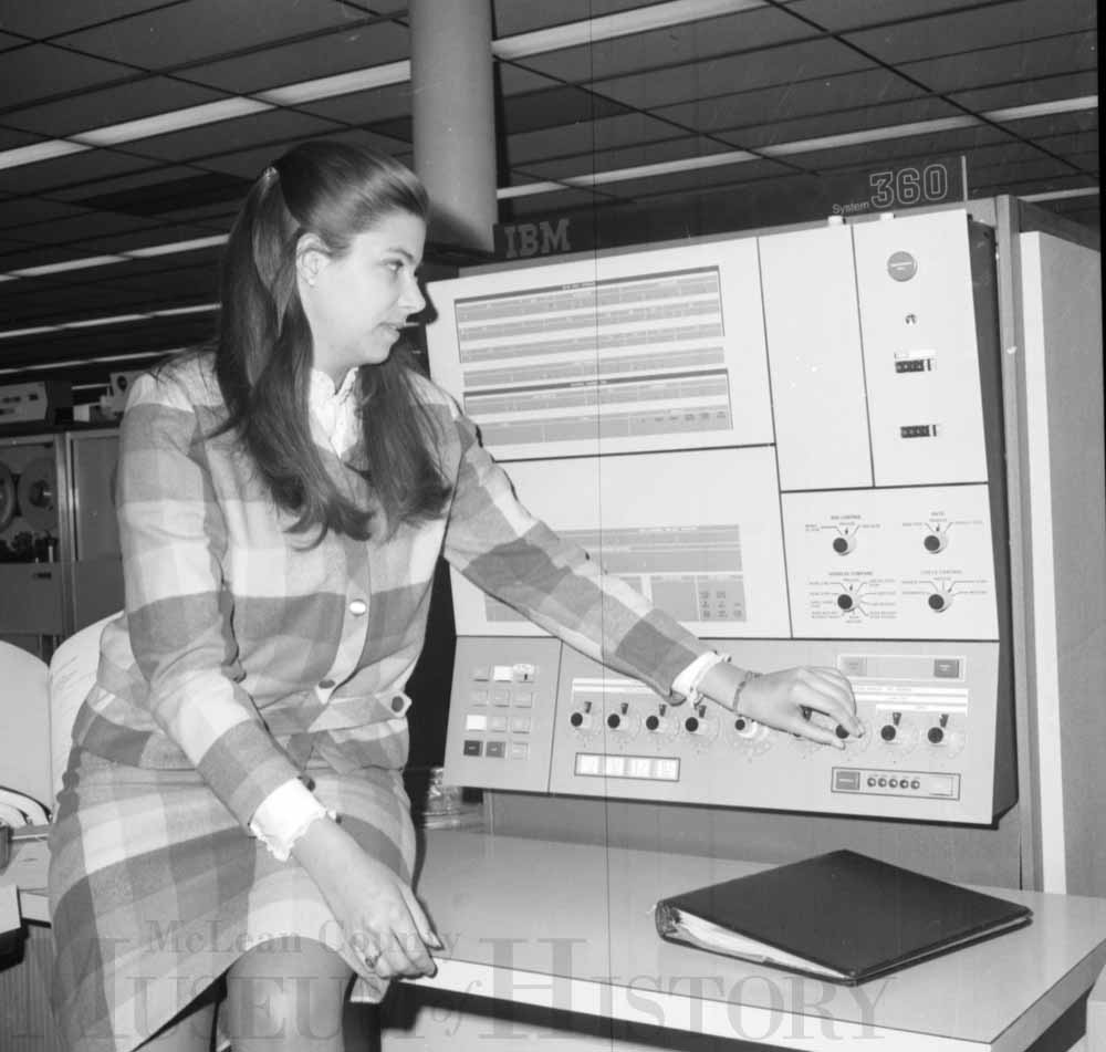 Susan Emrath sitting in front of an old computer, 1968.