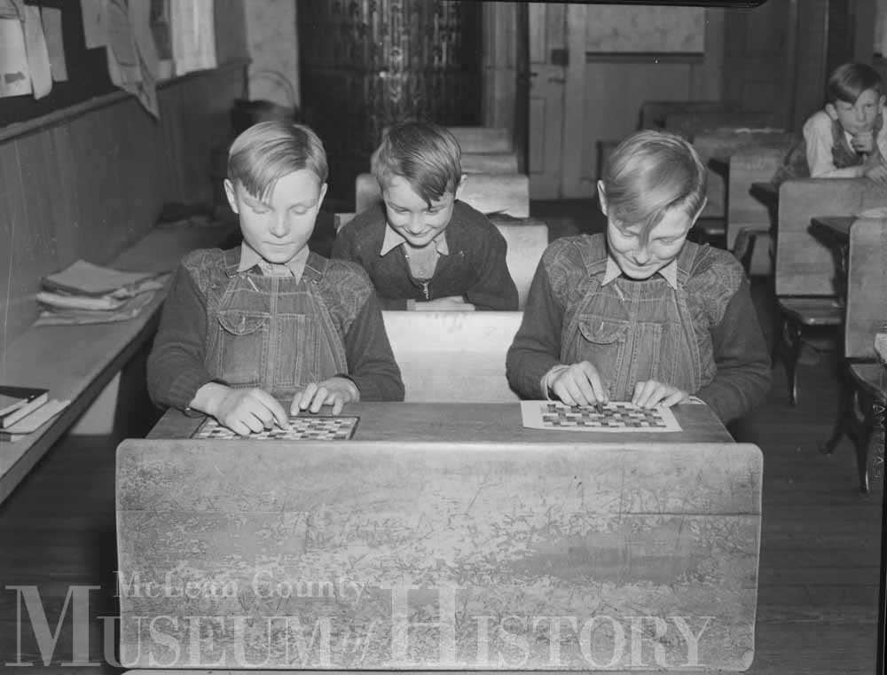 Three boys in school constructing a model home, 1938