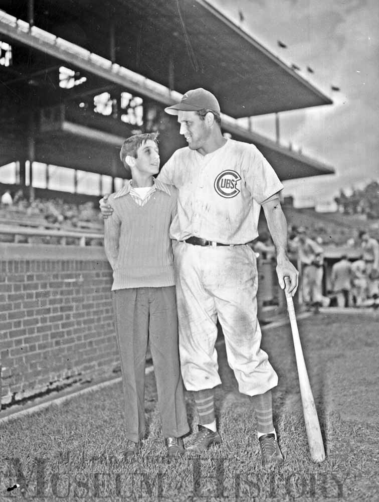 Junior baseball player meets Chicago Cubs player, 1947.