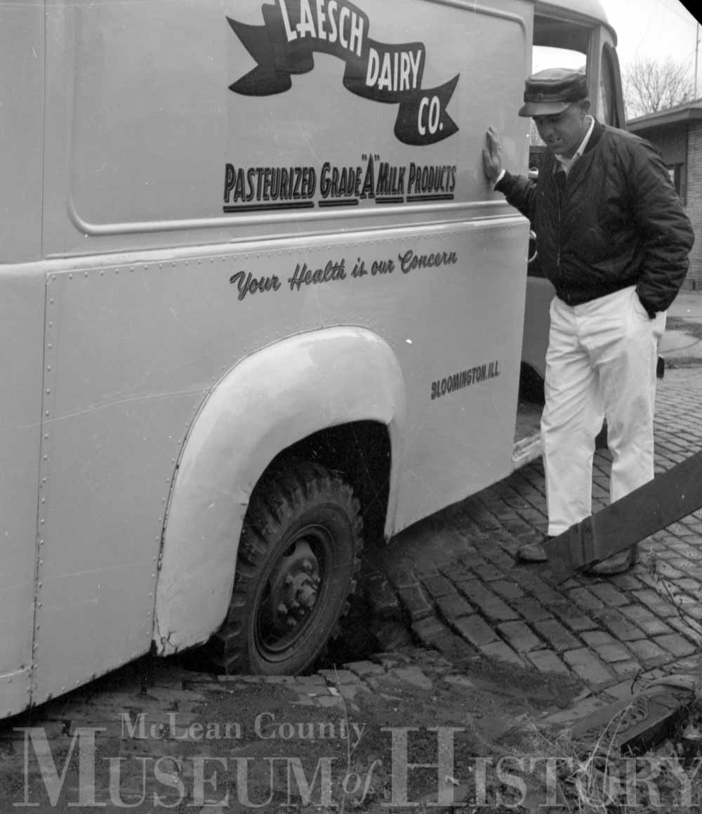 Man in front of a dairy truck, 1965.