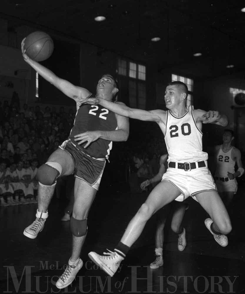 ​Gene Durham (22) of Saybrook-Arrowsmith High attempts a layup during the 1959 county tournament championship game.