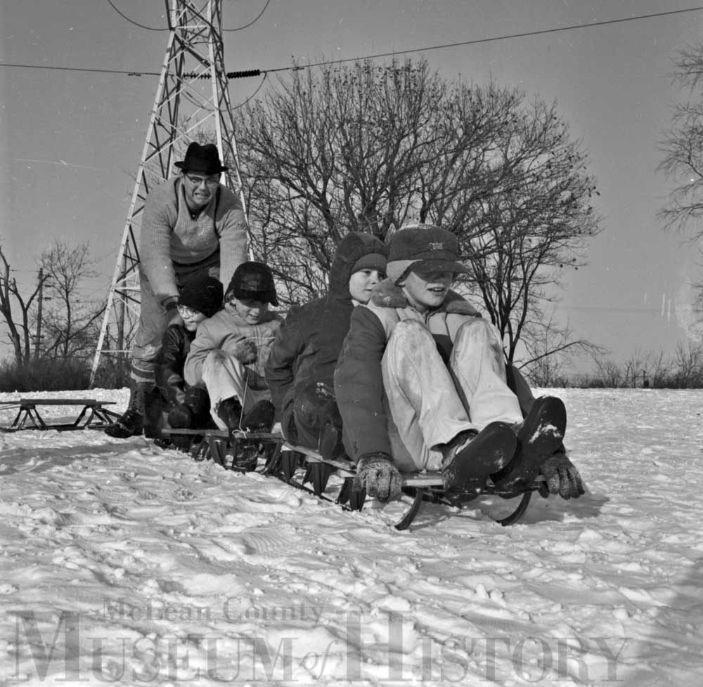 Group of orphans going sledding, 1963