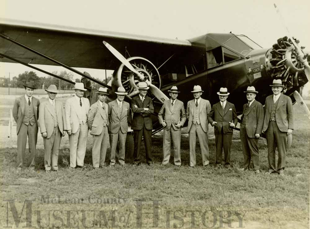 Men standing in front of Bloomington's first airport, 1931.