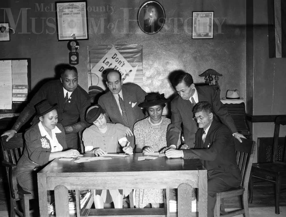 Seen here are Redd-Williams post members and auxiliary leaders planning a President's Birthday Ball for January 30, 1942.