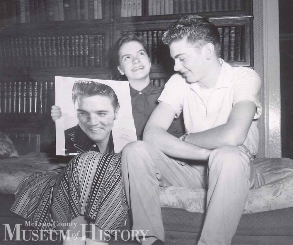 Teenagers holding a photo of Elvis, 1957.