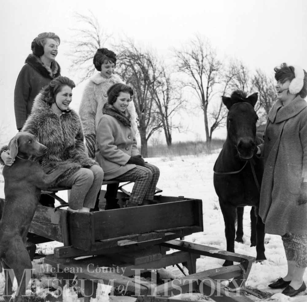 Unknown women enjoying a sleigh ride, 1963