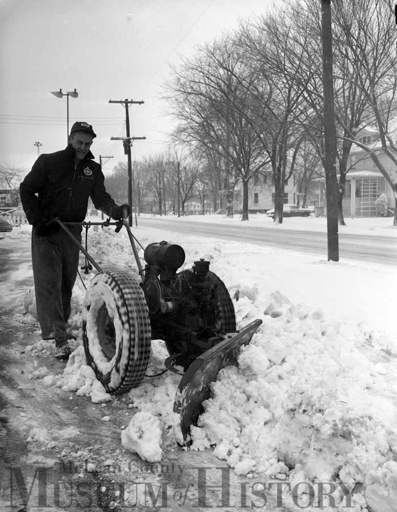 Two men out plowing the drive, 1953.