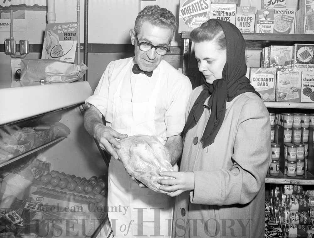 Ed Peifer and shopper, 1952.