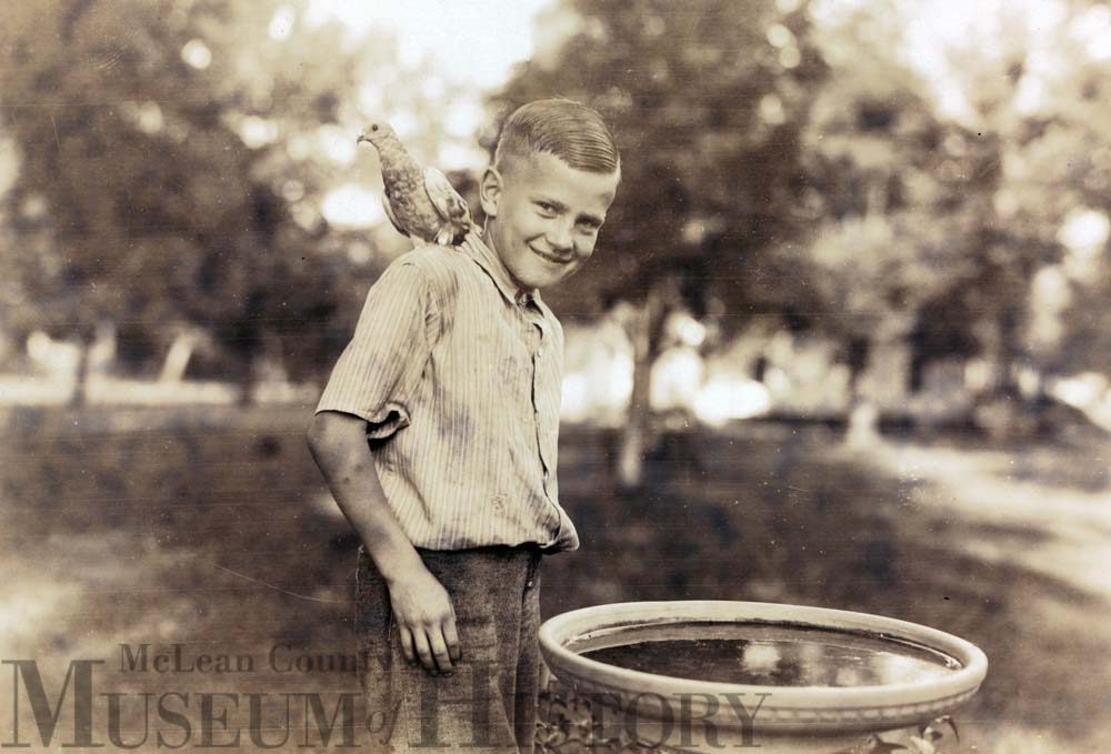 Victory Hall boy with a bird, 1930.
