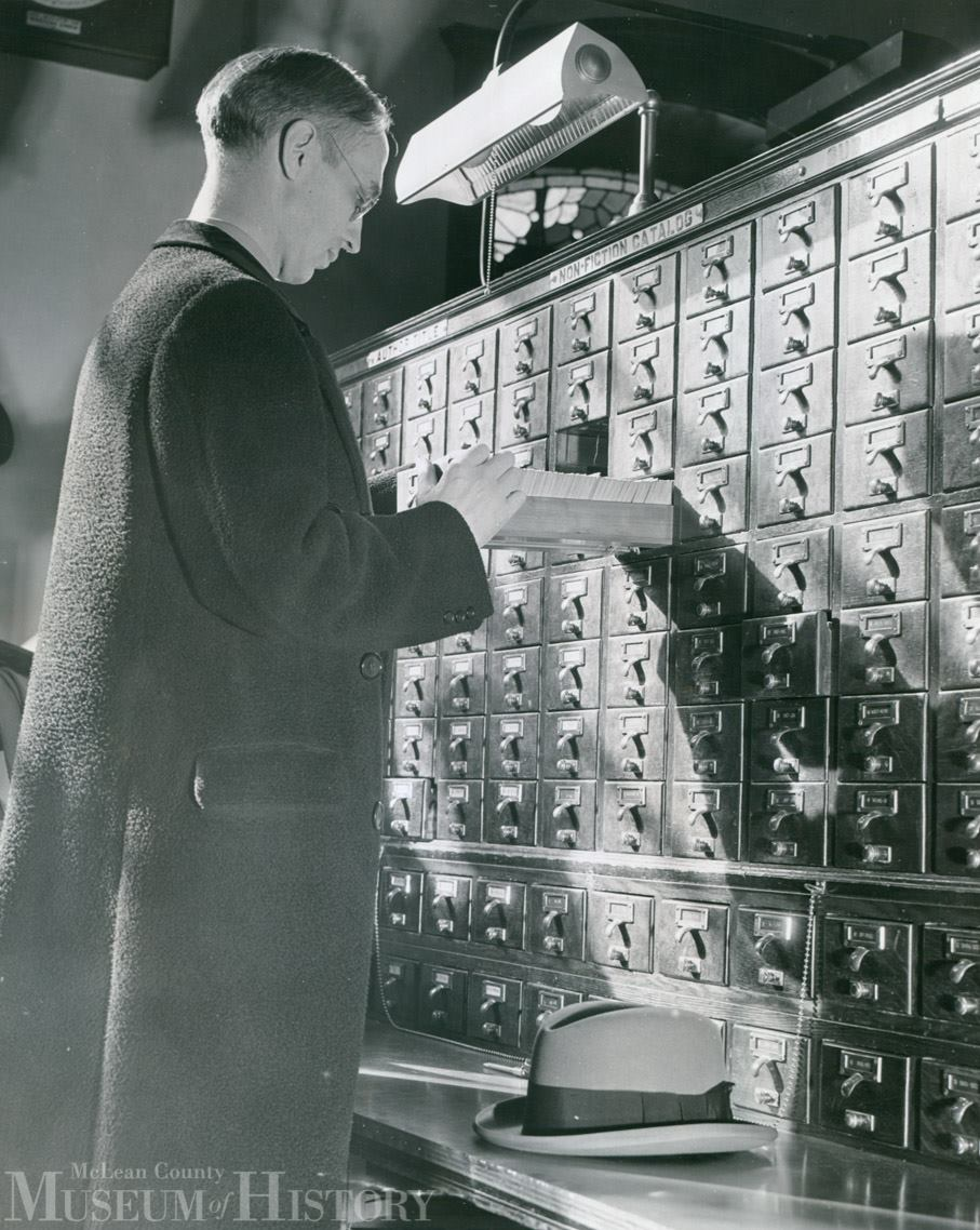 patron searches the Withers Public Library non-fiction card catalog in March 1940.