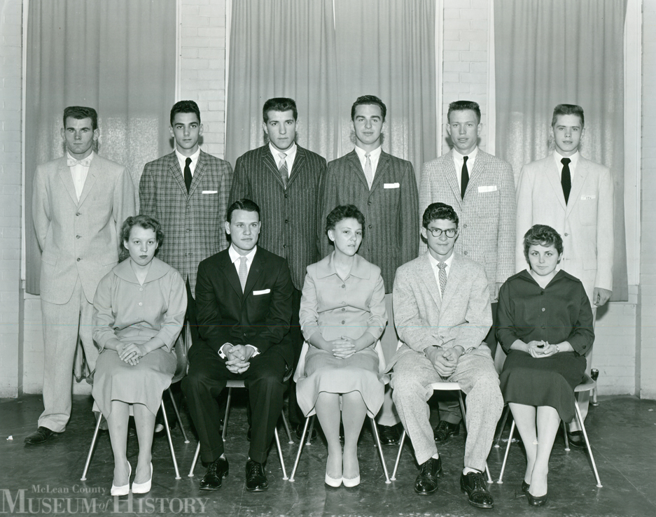 Illinois Soldiers' and Sailors' Children's School.  Dixie Chambers. Jack Cummings, Judy Harvey, Dick Peifer, and Betty Jo Naseef; back row (left to right), Bill Marrs, Leroy Witte, Joe Menton, Don Peterson, Richard Yeager, and Ronald Whitney. Menton was the U-High homecoming king.